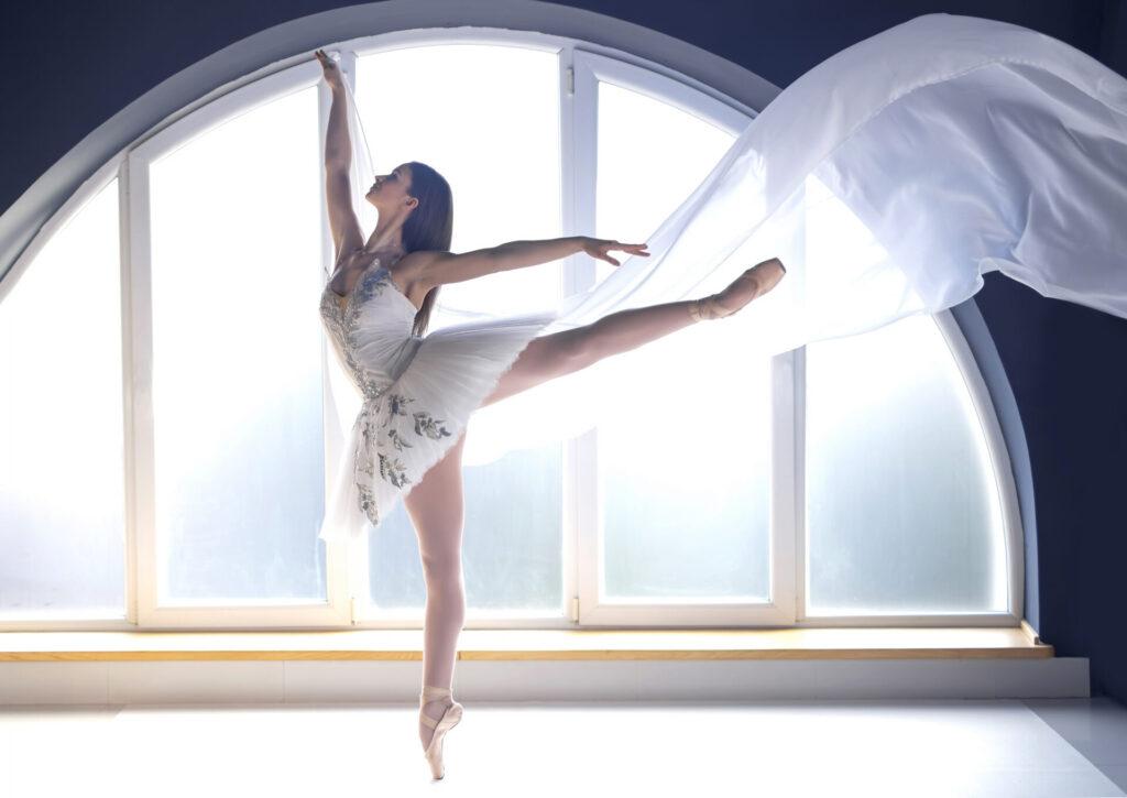 Youn motivated ballerina in white tutu